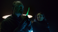Astra's associate inspects the Green Kryptonite dagger.png