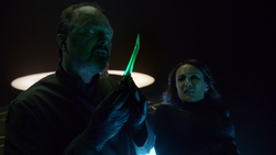 Astra's associate inspects the Green Kryptonite dagger