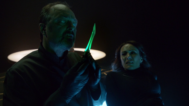 File:Astra's associate inspects the Green Kryptonite dagger.png