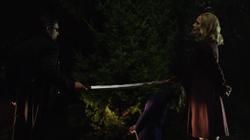 Slade murders Moira