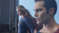 Supergirl and Superman flying together.png