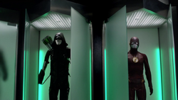 Green Arrow suit and the Flash suit side by side