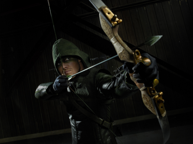 Файл:The Hood aiming his bow promo.png