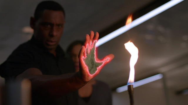 File:J'onn exposed at fire.png