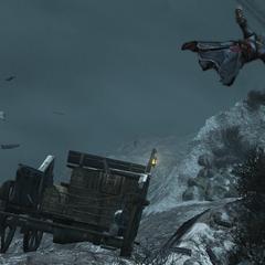 Ezio valt van zijn wagen af nadat de bom ontploft is
