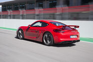 2016-Porsche-Cayman-GT4-rear-three-quarter-in-motion-11