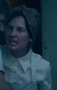 Raiko Bowman as Peeta's Mother