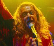Deep Roy as Oompa Loompas (Rock Band Member 1)