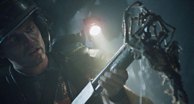 File:Hicks looks at Facehugger on shotgun.jpg