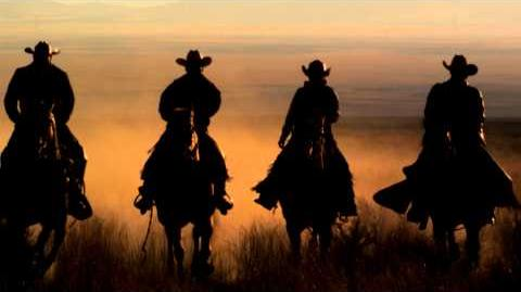Four cowboys riding horses at sunset. Slow motion HD & 4K stock video footage
