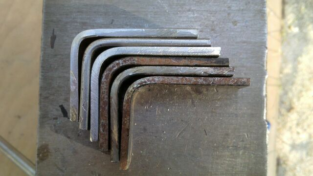 File:Bending pi-brackets using a wooden tool - 02.jpg