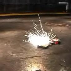 File:Sparks fly as AFWW strikes Ricochet.jpg