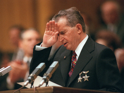 File:Ceausescu shields his eyes.jpg