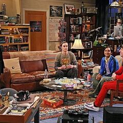 The gang playing cards at Leonard and Sheldon's apartment. Leonard is off on a date with Penny.