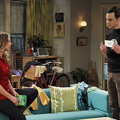 Sheldon presenting Penny her Cooper Coupons.
