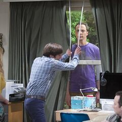 Howard closes the drapes to hide Sheldon.