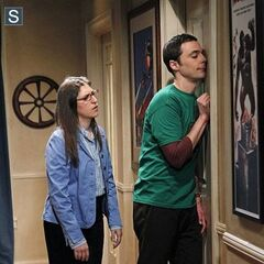Amy putting a drunk Sheldon to bed.