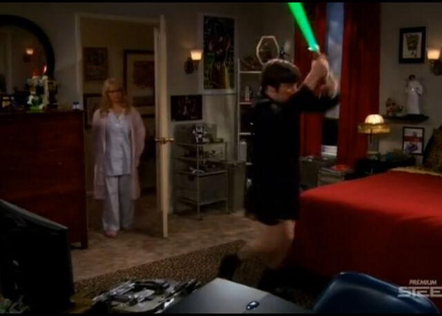 File:Howard plays with laser sword.jpg