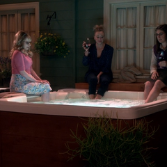 Daggling their feet in the hot tub.