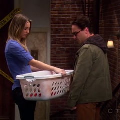 Leonard meets Penny on the way to do her laundry.