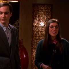Sheldon and Amy entering the restaurant.
