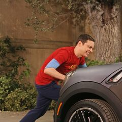 Sheldon tries to push Howard car out of his spot.