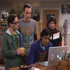 Raj speaking to his parents, as the rest of the guys look on.