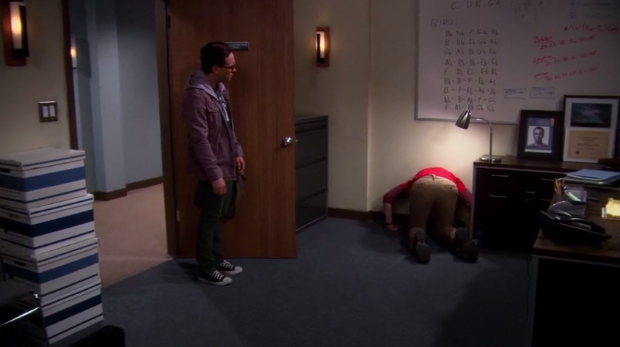 File:Sheldon's head is stuck in the wall.png