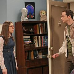 Sheldon is forgetting to kiss Amy good night.
