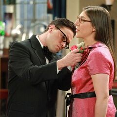 Leonard tries to put on a corsage for Amy.
