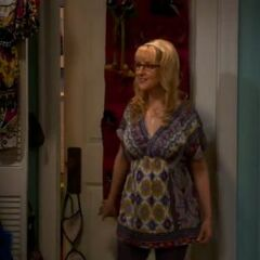 Bernadette trying on Penny's top.