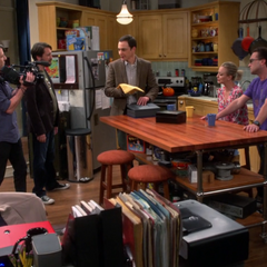 Sheldon getting out his valuables.