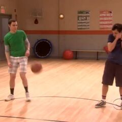 Sheldon and Kripke both avoid the ball thrown at them.