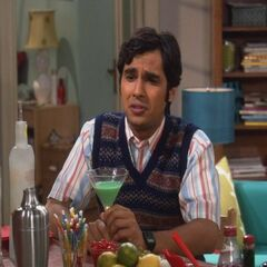 Raj drinks and talks to women.