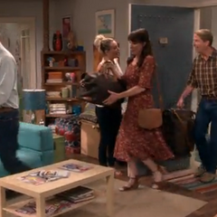 Penny's family arriving at her apartment.