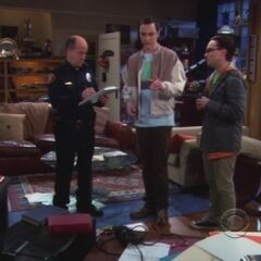 Leonard with Officer and Sheldon in robbed apartment.