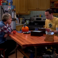 Penny talking things over with Sheldon.