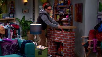 Leonard building a fireplace