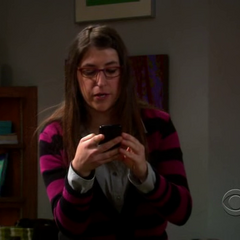 Amy looking at her phone.
