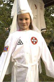 Kkk-child-in-robe1