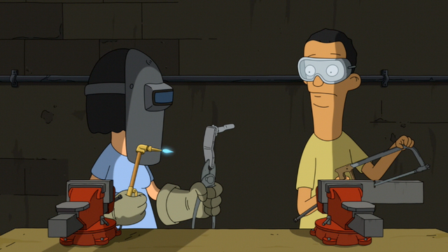 File:S4E07.08 Tina in Metal Shop.png