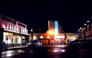 Statler Studebaker, Louis Watch Maker, Town Theater and Holt's Diner by night
