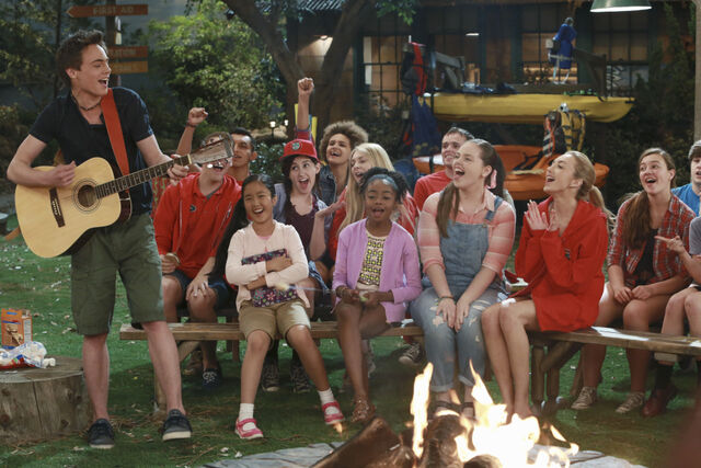 File:Pilot (Xander playing guitar with Tiffany, Zuri, Lou, and Emma laughing) Campfire.jpg
