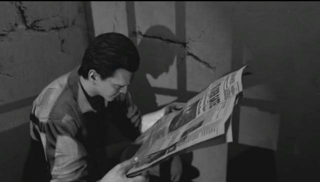 "File:MOTD Michael ""Finn"" O'Leary reading newspaper BOII.png"