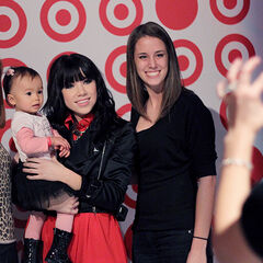Carly holds another young fan and poses for another picture!