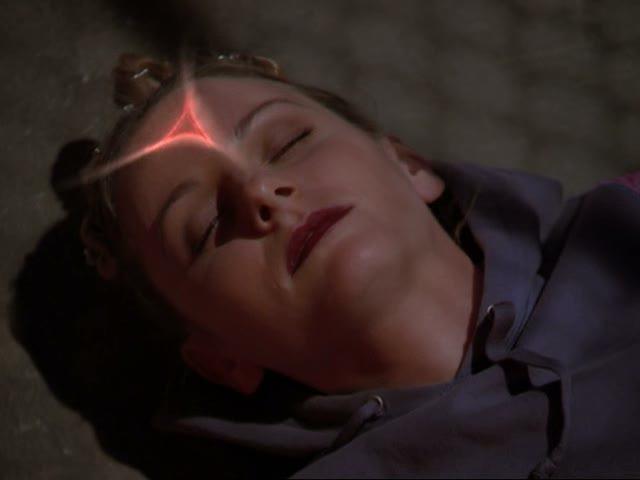 File:Rune glows on dead raver girl.jpg