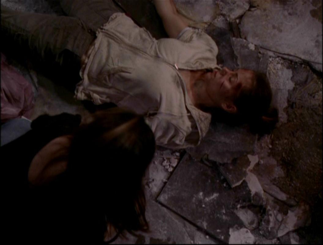 Phoebe lying dead in ruins
