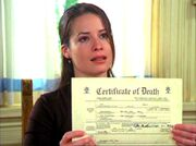 3x20-Piper-with-Leo's-death-certificate