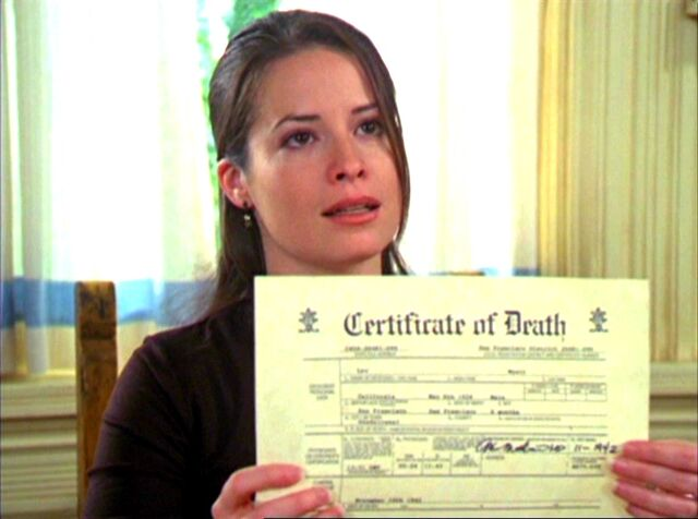 File:3x20-Piper-with-Leo's-death-certificate.jpg