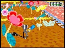 File:Flowers being watered.jpg